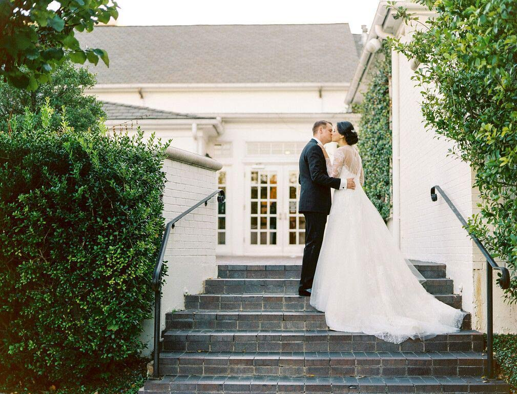 Bride and groom take a wedding day portrait at Arlington Hall Dallas