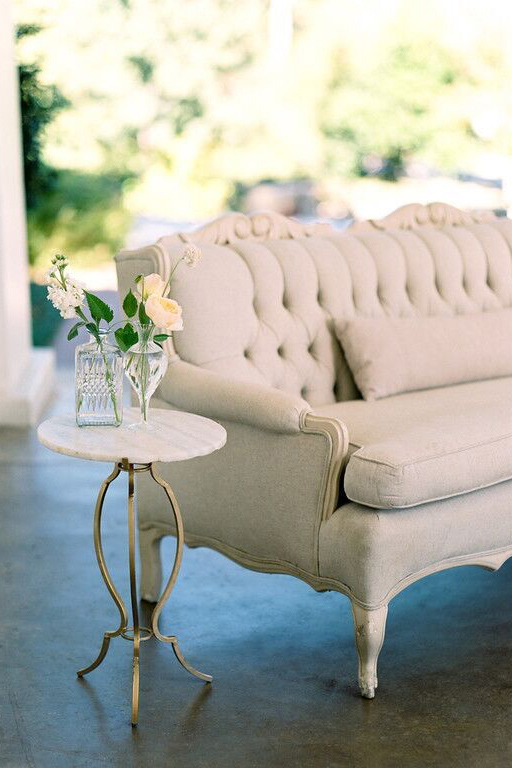 Bella Acento wedding reception sofa and end table on Arlington Hall back porch