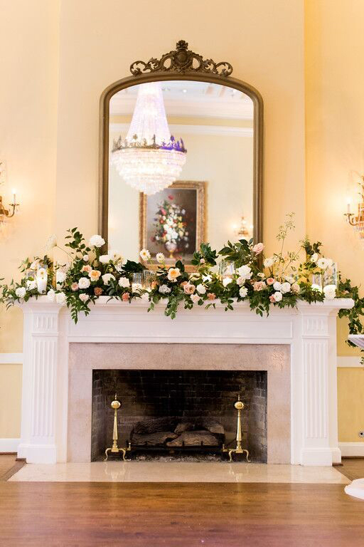 Arlington Hall fireplace mantle covered in greenery and blooms