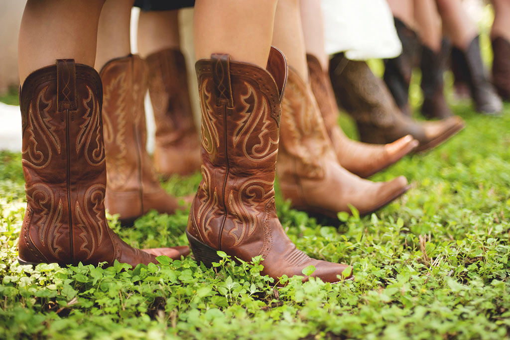 Bridesmaids wearing cowboy boots