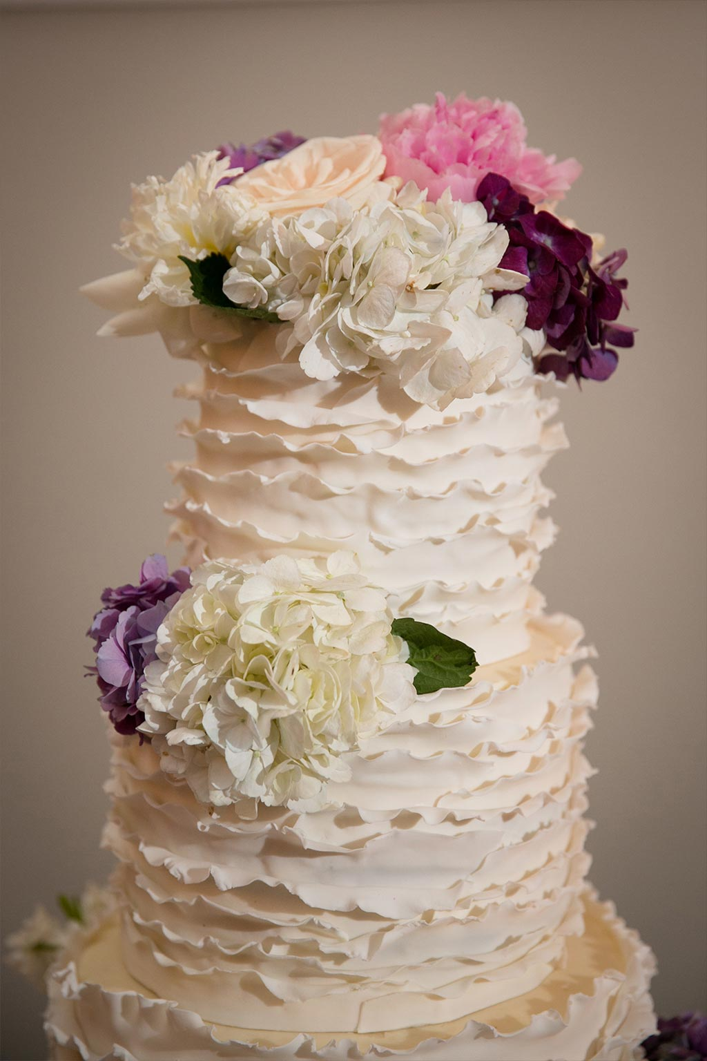Ruffle Wedding Cake with Floral Topper