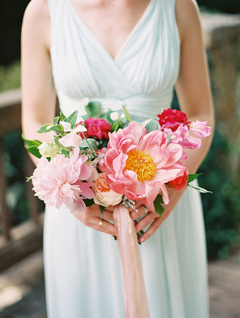 Pink and peach wedding bridesmaid bouquet with ribbon streamer