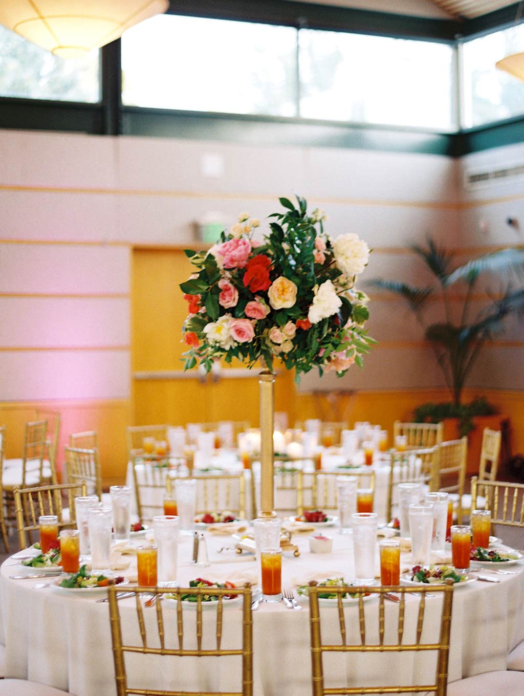 Tall round table centerpiece at wedding reception at Rosine Hall at The Dallas Arboretum