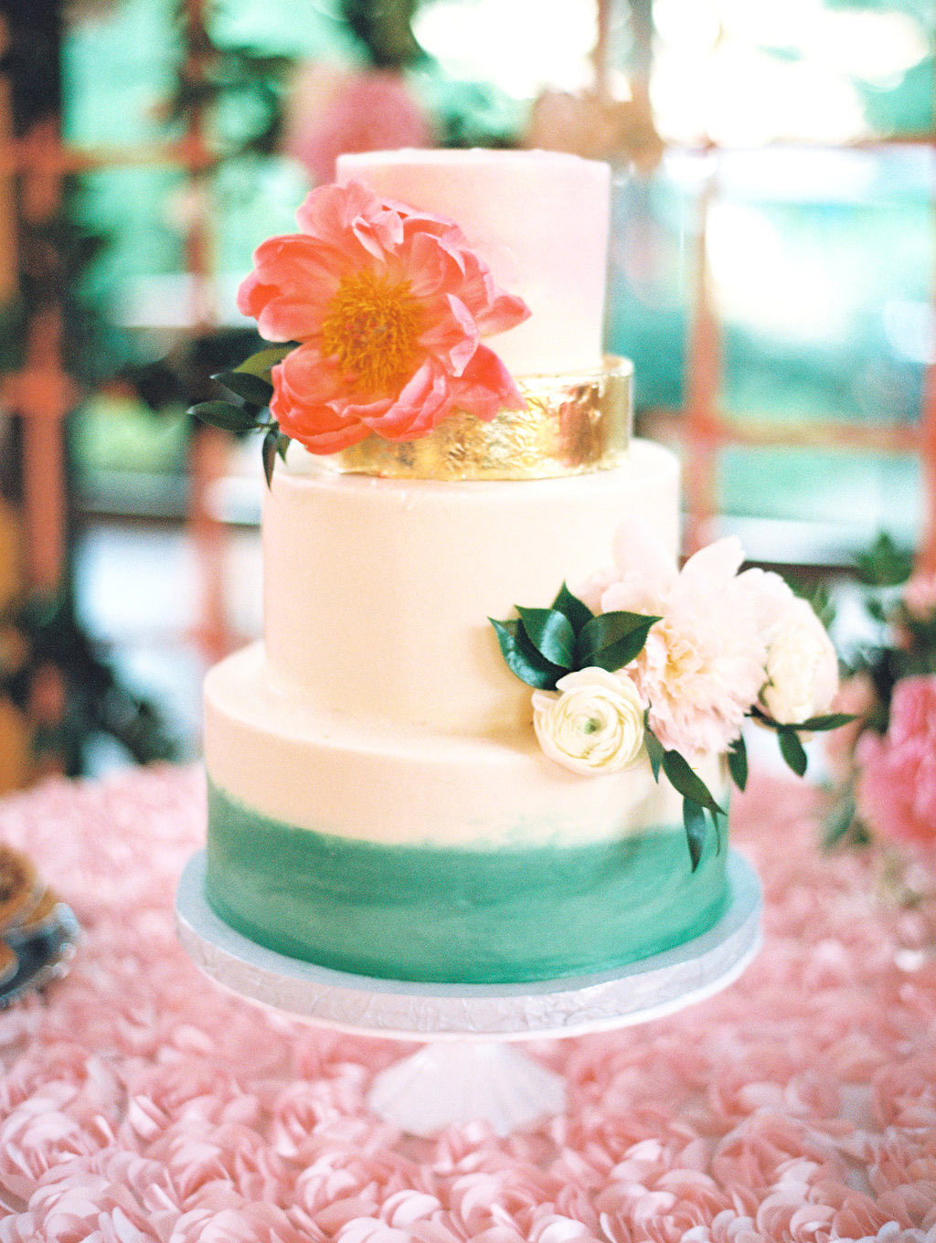 Watercolor bridal wedding cake with metallic gold layer and fresh flowers