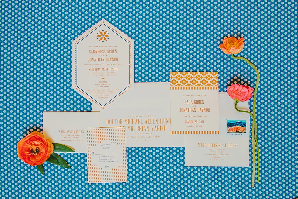 Die cut orange and blue letterpress wedding invitation suite