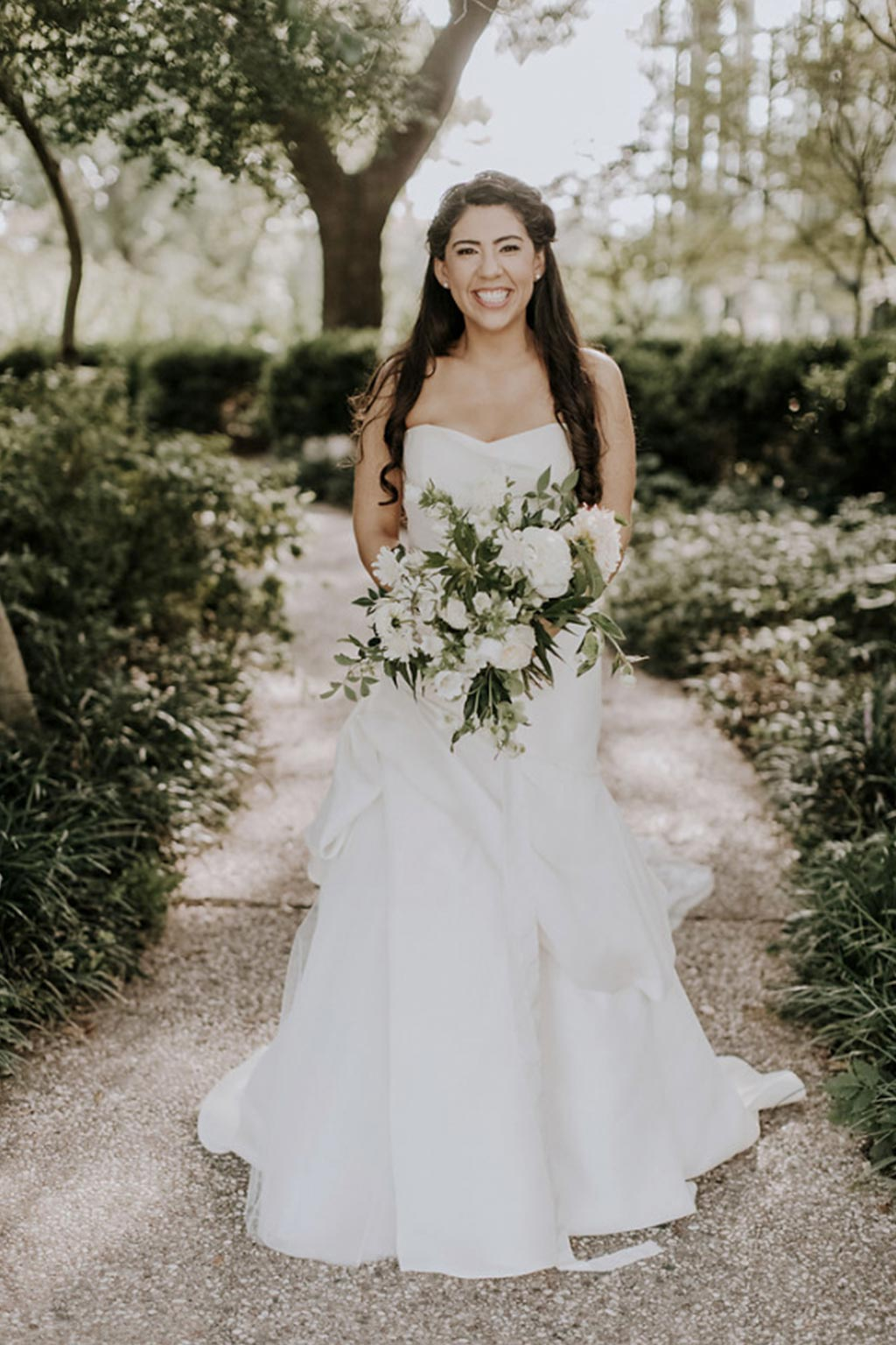 Wedding day garden bridal portrait with white and green natural bouquet and Madison by Monique Lhuillier sleeveless wedding dress