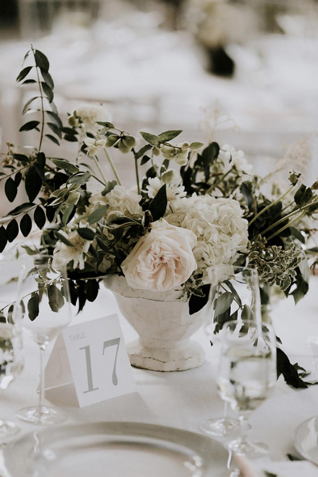 Green and white organic garden wedding low centerpiece with table number