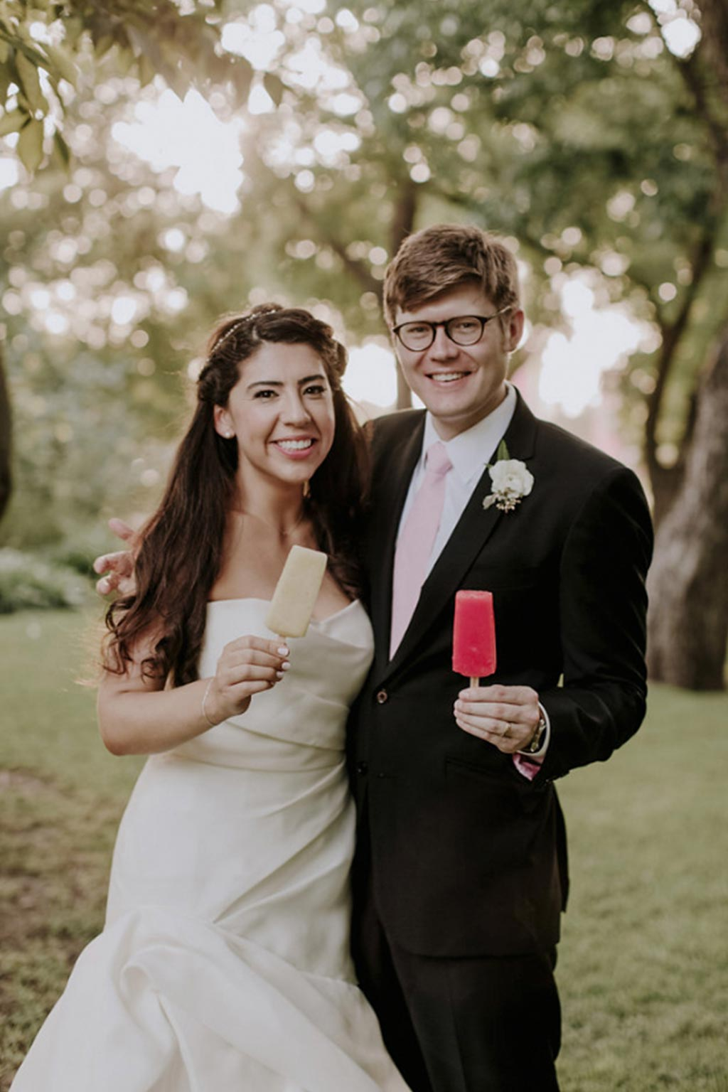 Bride and groom wedding portrait with Steel City Pops popsicles
