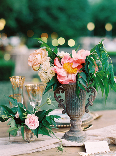 Wedding centerpiece urn and gold-rim glasses