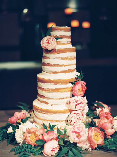 4-tier naked wedding cake with smeared buttercream and pink and peach fresh floral by Sugar Bee Sweets